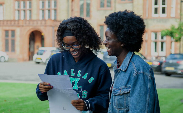 Sixth form student receiving successful A-Level exam results at St Margaret's School Bushey