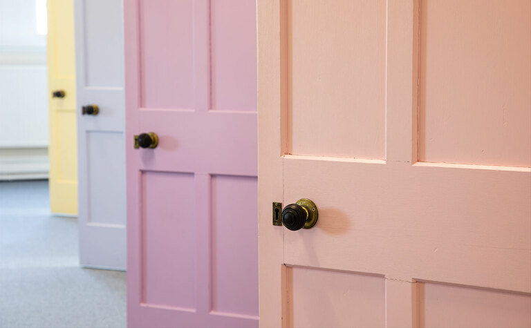 Pretty pastel coloured doors in one of the boarding houses at St Margaret's School