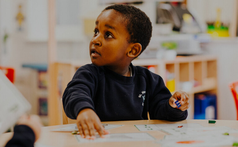 Three year old boy at St Margaret's co-educational independent school in Bushey Hertfordshire
