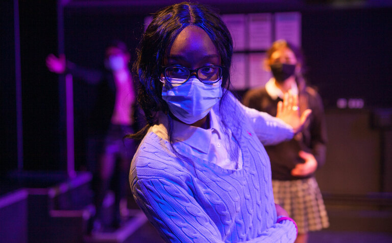 Sixth form student in drama performance at St Margaret's School Bushey