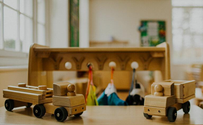 Wooden toys on display in nursery school offering 15 hours funding at St Margaret's School