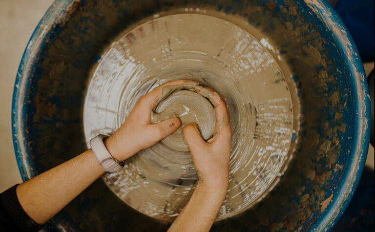 St Margarets School pupil using pottery wheel in art lesson