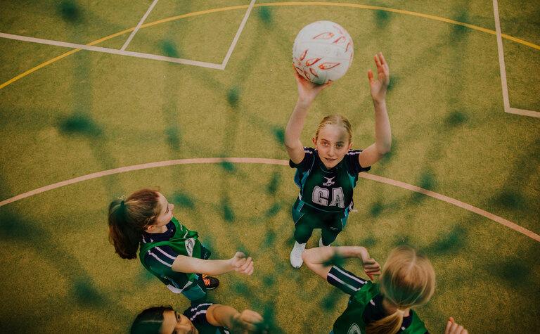 View through net at St Margaret's School senior girls netball team