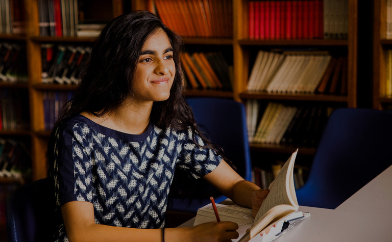 St Margarets School Sixth Form pupil studying in library