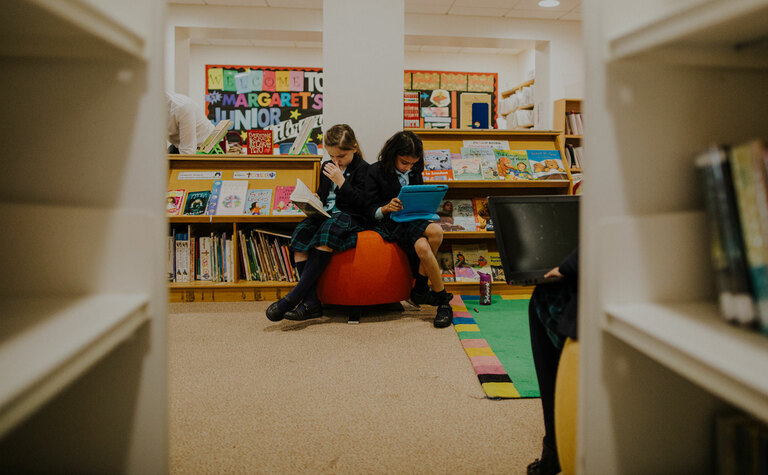 Two upper junior school pupils studying in the library at St Margaret's School Bushey