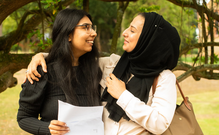 St Margarets School Pupil and mother hugging and smiling after successful exam results