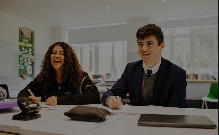 Two Sixth Form students studying in classroom at St Margaret's School Bushey