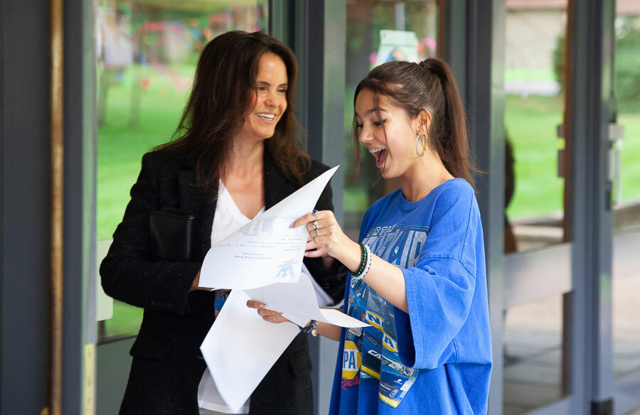 Mother and St Margaret's School pupil opening GCSE results 2021