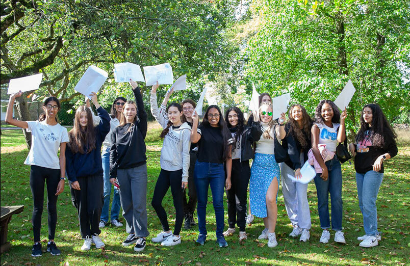 Group of St Margaret's School pupils with exam results
