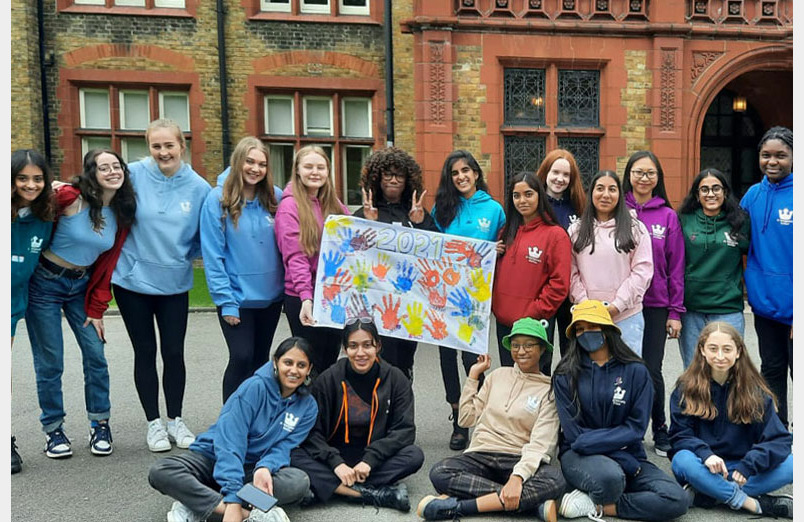 St Margaret's Sixth Form Students outside front of Waterhouse in 2021 Leaver's Hoodies