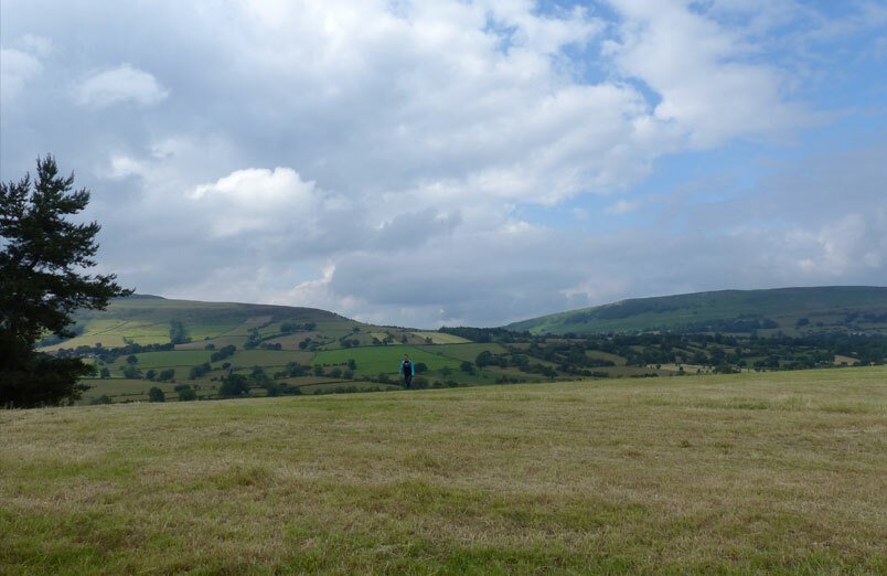 Panoramic view of countryside with one student on their Duke of Edinburgh's expedition