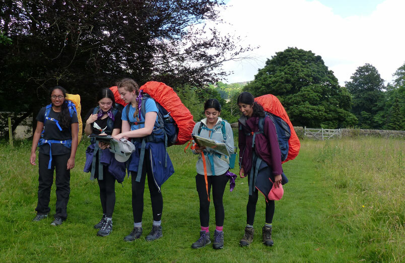 A group of St Margaret's School pupils map reading on the expedition section of their DofE award