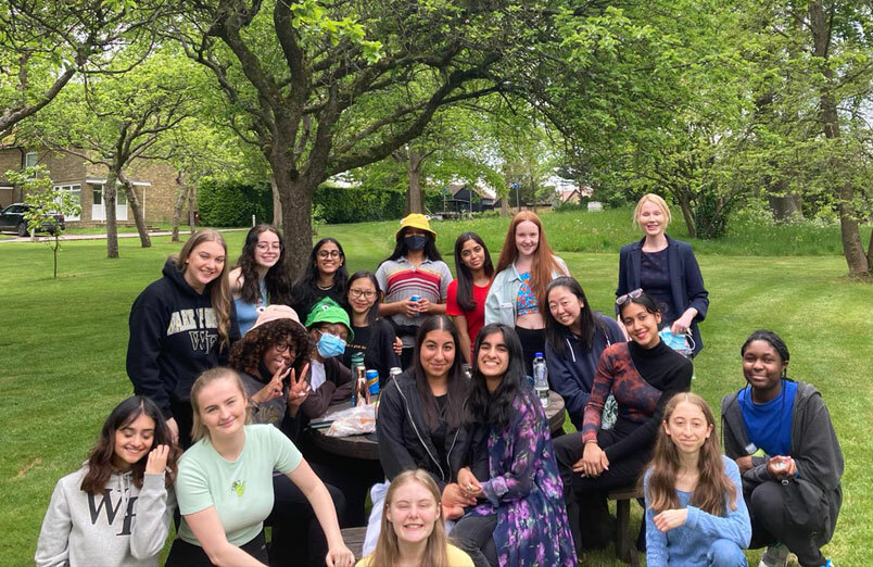 St Margaret's Year 13 Sixth Form Last Day at School celebrating in orchard