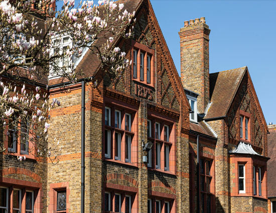 The front of the main Waterhouse School building at St Margarets School with a blossoming magnolia tree in foreground