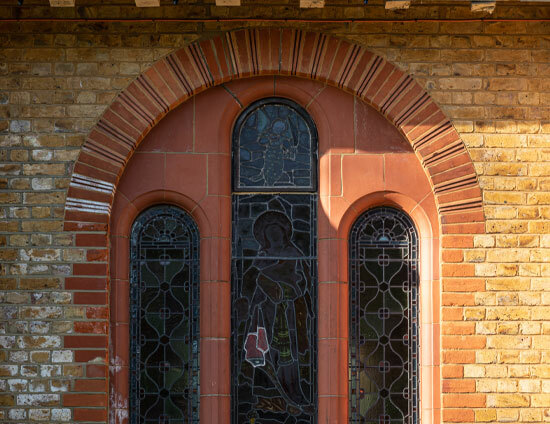 One of the stained glass arched windows of the Waterhouse building at St Margaret's School Bushey