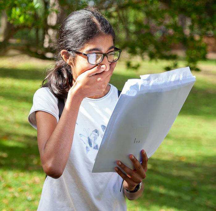 Overwhelmed Senior School pupil from St Margaret's Bushey opening exam results letter