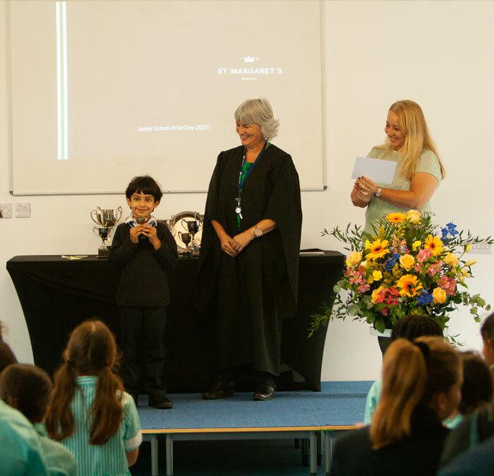 Junior School Prize Winner collecting trophy in September 2021