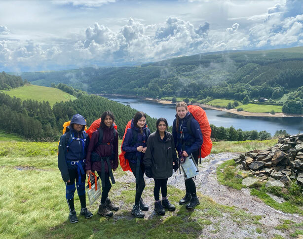 Group of pupils standing above a lake on their Duke of Edinburgh's Award expedition